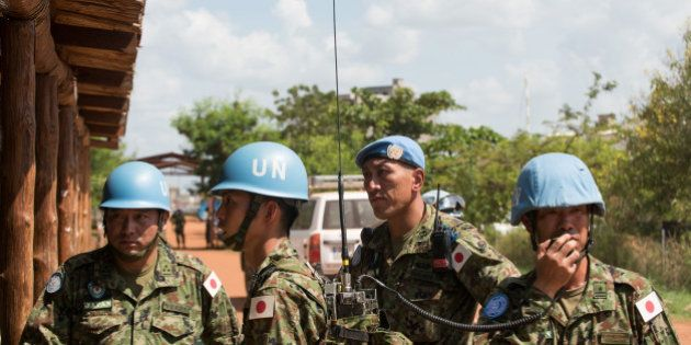 Japanese United Nations Mission in the Republic of South Sudan (UNMISS) troops wait for the arrival of...