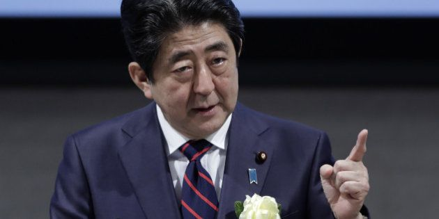Shinzo Abe, Japan's prime minister, gestures as he speaks at business federation Nippon Keidanren in...