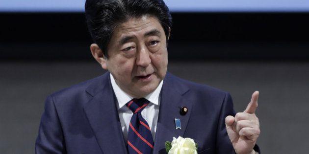 Shinzo Abe, Japan's prime minister, gestures as he speaks at business federation Nippon Keidanren in...