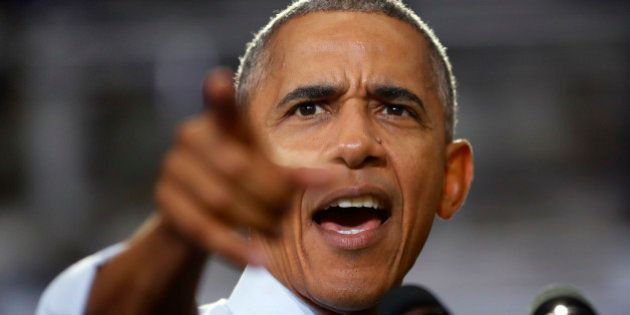 President Barack Obama points to members of the audience while speaking at Capital University Field House...
