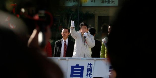 Japan's Prime Minister and President of ruling Liberal Democratic Party Shinzo Abe delivers a speech...