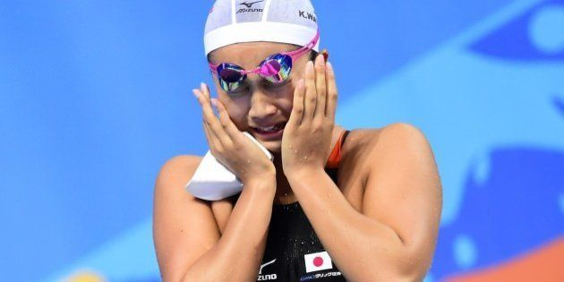 Japan's Kanako Watanabe celebrates after winning the final of the women's 200m breaststroke swimming...