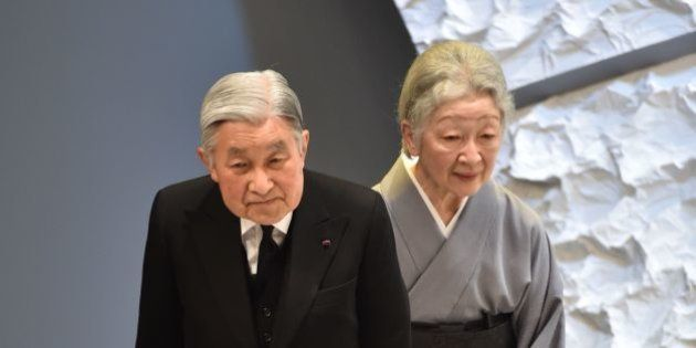 Japanese Emperor Akihito (L) and Empress Michiko (R) bow towards the audience as they leave the national...