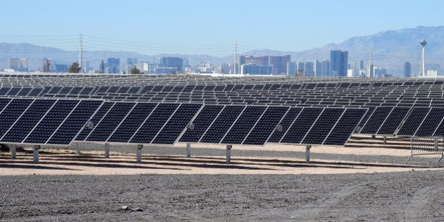 LAS VEGAS, NV - FEBRUARY 16: The Las Vegas Strip is shown behind solar panels during a dedication ceremony...