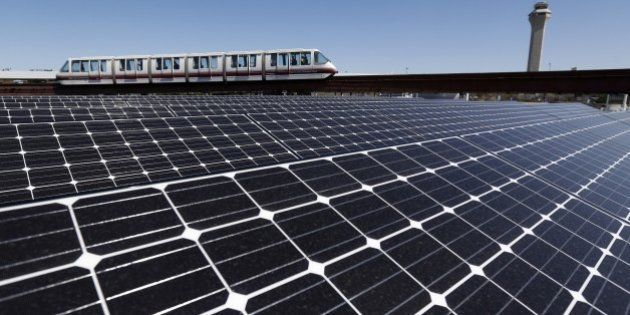 Solar panels that were recently placed on the roof of the building supplying energy to the AirTrain at...
