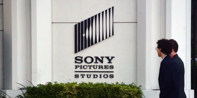 Pedestrians walk past an exterior wall to Sony Pictures Studios in Los Angeles, California on December...
