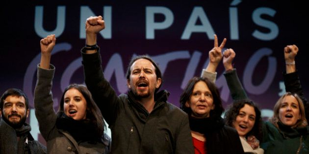 Podemos party leader Pablo Iglesias, center, and other party leaders celebrate following the latest official...
