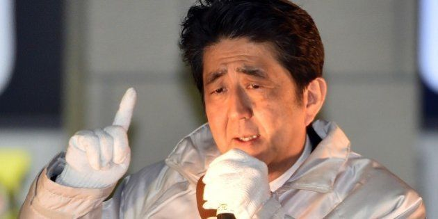 Japanese Prime Minister and ruling Liberal Democratic Party (LDP) leader Shinzo Abe delivers a campaign...