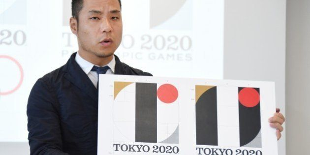 Tokyo Olympic logo designer Kenjiro Sano explains his design during a press conference at the headquarters...