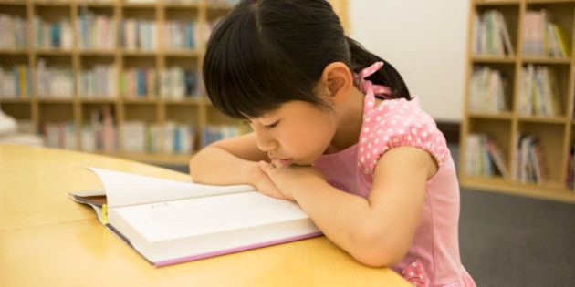 Girl reading a book in the