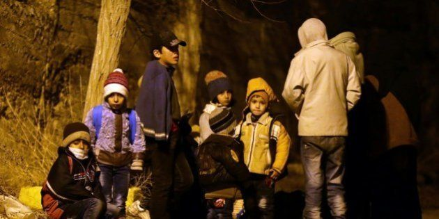 Syrian children wait on the outskirts of the besieged rebel-held Syrian town of Madaya, on January 11,...