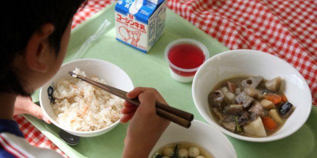 JAPAN - JANUARY 26: A school girl have school lunch at Senzoku Elementary School in Tokyo, Japan, on...