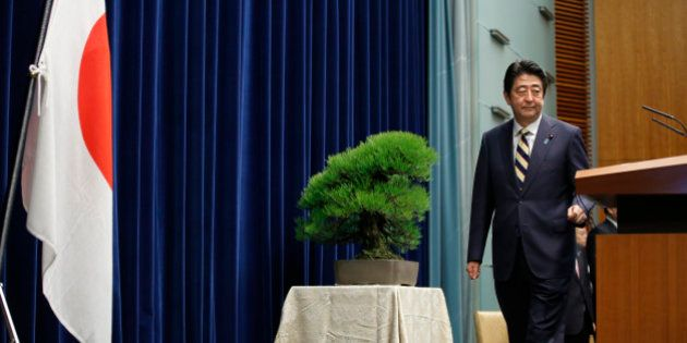 Japanese Prime Minister Shinzo Abe poses to the media before a new year's press conference at his official...