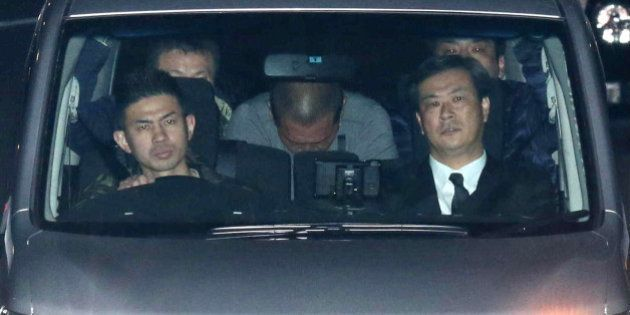 Former Japanese baseball star Kazuhiro Kiyohara (C) is transported into the Tokyo metropolitan police...