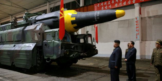FILE PHOTO - North Korean leader Kim Jong Un inspects the long-range strategic ballistic rocket Hwasong-12...