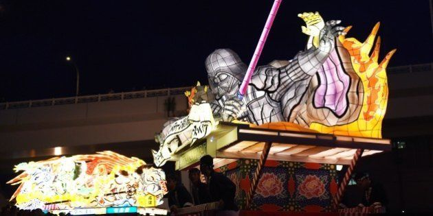 Students carry the Star Wars Sith Nebuta float featuring Darth Maul, Sheev Palpatine and Darth Vader...