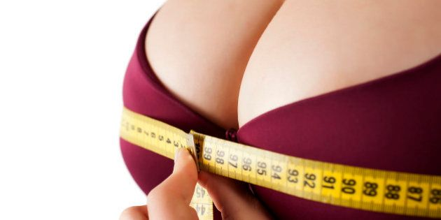 woman measured her huge breast with a measuring