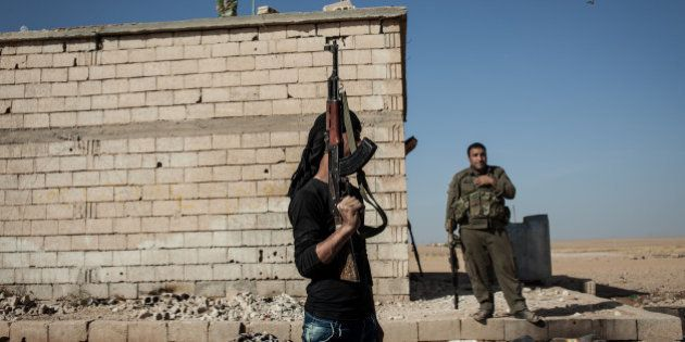 RAQQA COUNTRYSIDE, OCTOBER 17: Members of the Syrian armed group Liwa Thuwar al-Raqqa hold positions...