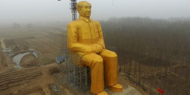 TOPSHOT - This photo taken on January 4, 2016 shows a huge statue of Chairman Mao Zedong under construction...