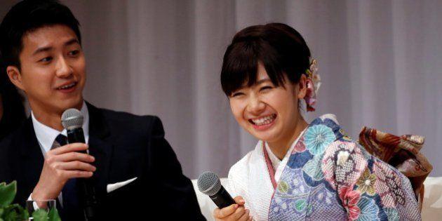 Japan's table tennis Olympian Ai Fukuhara (R) and her husband Taiwan's table tennis Olympian Chiang Hung-chieh...