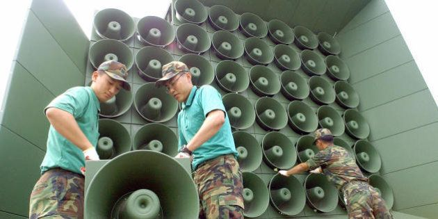 PAJU, REPUBLIC OF KOREA: South Korean soldier tear down a battery of propaganda loudspeakers along the...