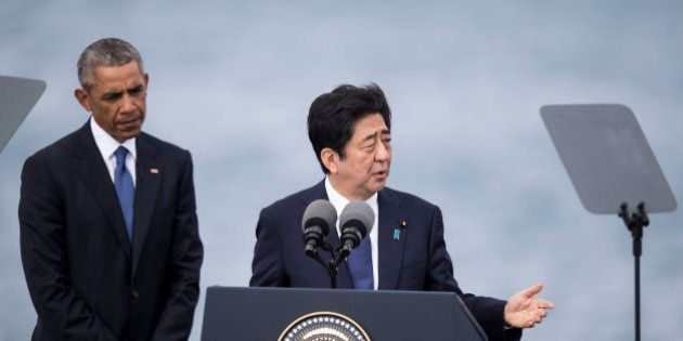 HONOLULU, HI - DECEMBER 27: U.S. President Barack Obama listens while Japanese Prime Minister Shinzo...