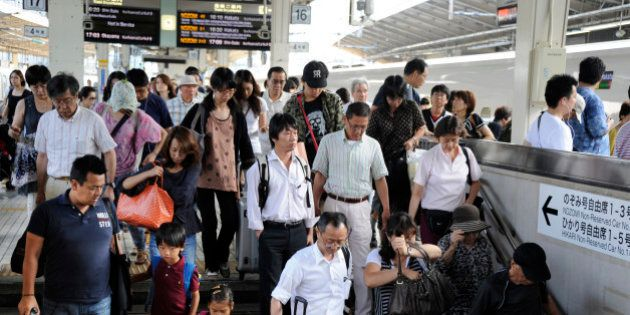 Thousands of holidaymakers return back to Tokyo by 'shinkansen', commonly known as the bullet train,...