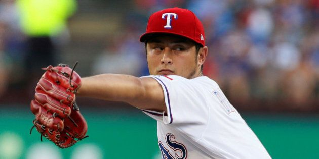 Jul 26, 2017; Arlington, TX, USA; Texas Rangers starting pitcher Yu Darvish (11) throws a pitch in the...