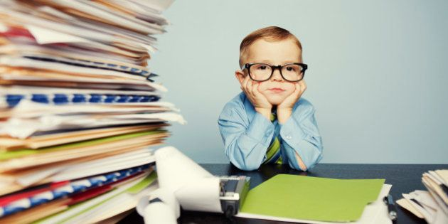 A young boy accountant has too much work to do at the office. Too much stress this tax