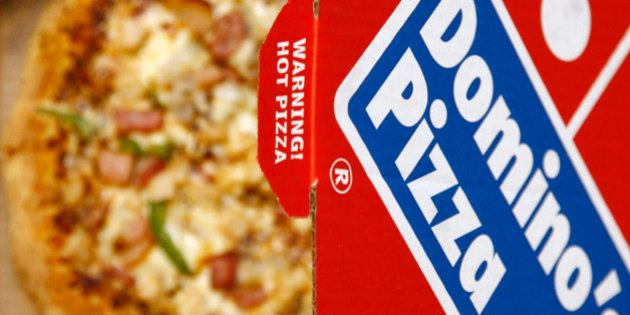 A Domino's Pizza is pictured in its box in central London, February 15, 2009. Britain's biggest pizza...