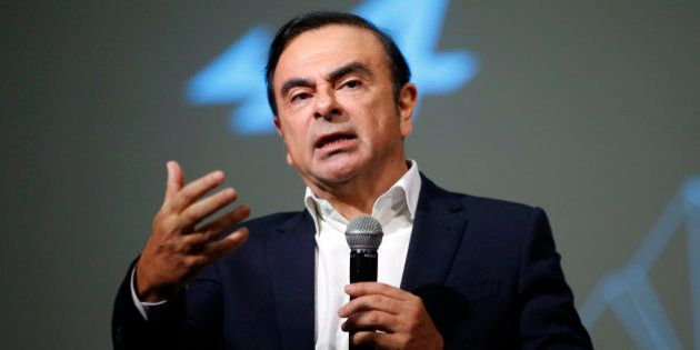 Carlos Ghosn, Chairman and CEO of the Renault-Nissan Alliance, gestures as he speaks during the presentation...