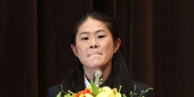 TOKYO, JAPAN - DECEMBER 17: Homare Sawa bites her lips during the news conference on December 17, 2015...
