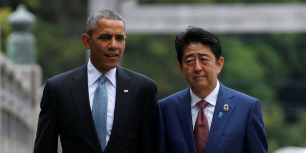 U.S. President Barack Obama (L) talks with Japanese Prime Minister Shinzo Abe on Ujibashi bridge as they...