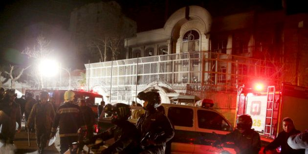 Iranian security protect Saudi Arabia's embassy in Tehran, Iran, while a group of demonstrators gathered...