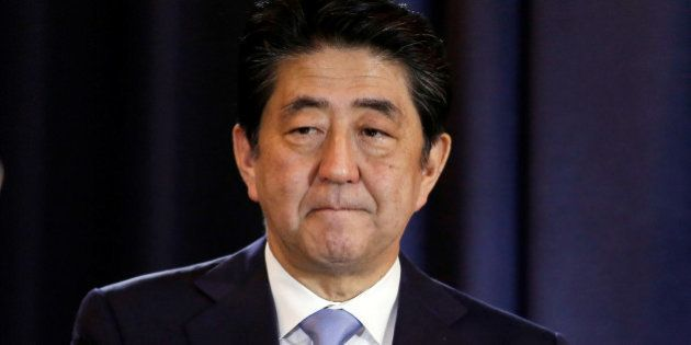 Japanese Prime Minister Shinzo Abe gestures during a press conference in Buenos Aires, Argentina, November...