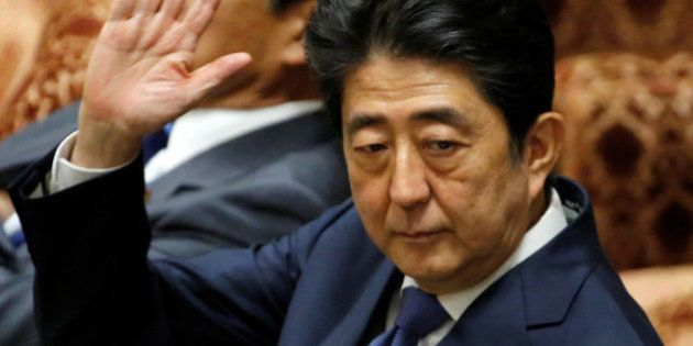 Japan's Prime Minister Shinzo Abe attends a lower house budget committee session at the parliament in...