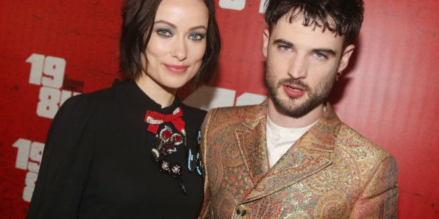 NEW YORK, NY - JUNE 22: Olivia Wilde and Tom Sturridge pose at the opening night party for '1984' on...