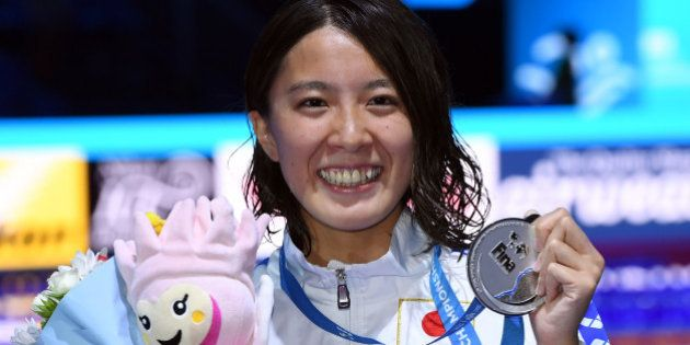 Japan's Yui Ohashi celebrates on the podium after the women's 200m Individual Medley final during the...