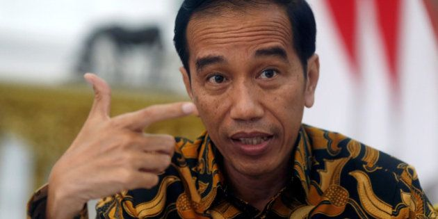 Indonesia's President Joko Widodo gestures during an interview with Reuters in Jakarta, Indonesia, July...