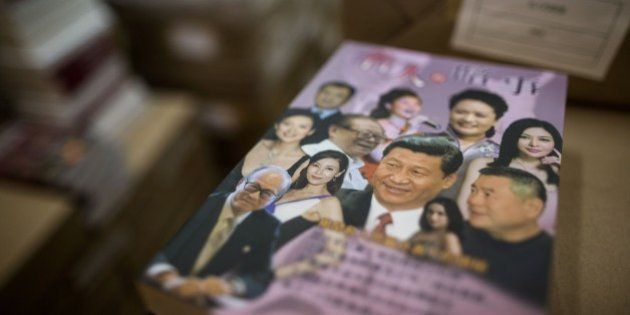 A book with Chinese President Xi Jinping (C on book) is displayed at the warehouse of Hong Kong-based...