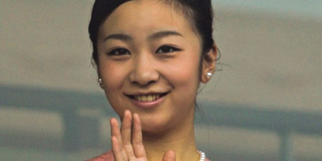 Princess Kako wave to well-wishers during the Japanese royal family's New Year public appearance at the...