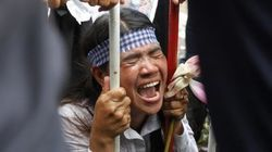 カンボジア:土地権利活動家に対する訴追取下げを