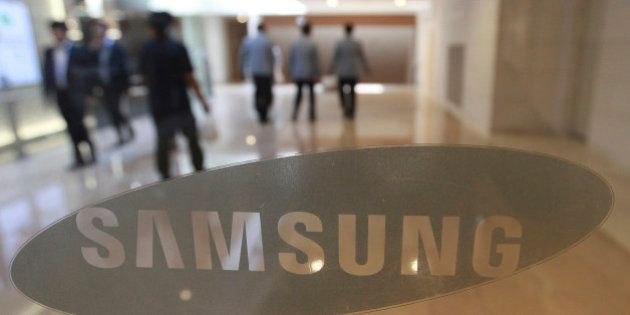 The corporate logo of Samsung Electronics Co. is seen at its shop in Seoul, South Korea, Wednesday, Oct....