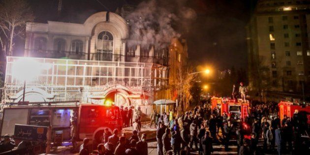 Iranian protesters set fire to the Saudi Embassy in Tehran during a demonstration against the execution...