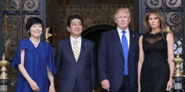 US President Donald Trump (centre R), Japans Prime Minister Shinzo Abe (centre L), Trump's wife Melania...