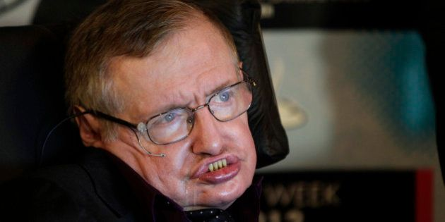 Physicist and best-selling author Stephen Hawking listens to questions from reporters, Saturday, June...