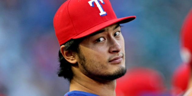 Apr 27, 2016; Arlington, TX, USA; Texas Rangers starting pitcher Yu Darvish (11) sits in the dugout during...