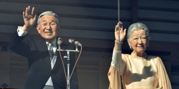 Japanese Emperor Akihito (L) and Empress Michiko wave to well-wishers gathered for the annual New Year's...