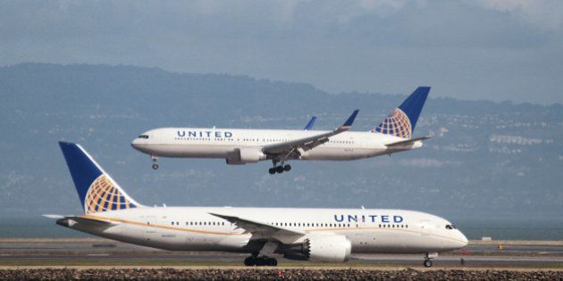 A United Airlines Boeing 787 taxis as a United Airlines Boeing 767 lands at San Francisco International...