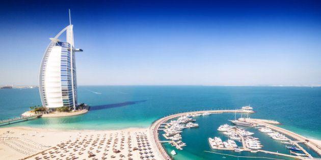 Dubai, United Arab Emirates - December 10, 2014: The Burj Al Arab Hotel, left side on the beach near...